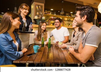 A group of friends making a order at cafe