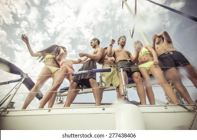 group of friends making party on the boat. concept about transportation, fun, happiness,youth, boat and people