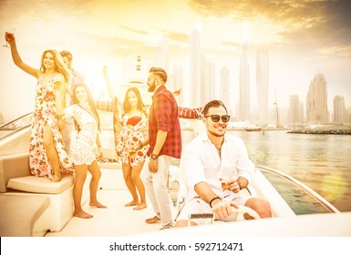 Group of friends making party on a yacht in Dubai. Motivational concept about friendship and party mood