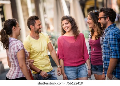 Group of friends meeting in the city