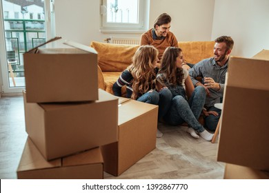 Group of friends moving into new apartment