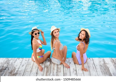Group of friends near outdoor swimming pool