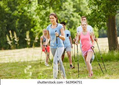 Group of friends nordic walking for leisure