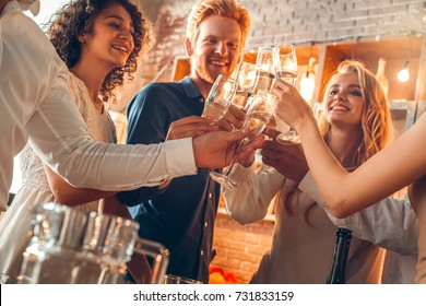 Group of friends party together indoors celebration