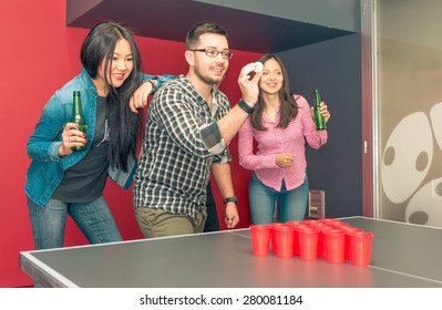 group of friends playing beer pong. concept about students, and games with friends