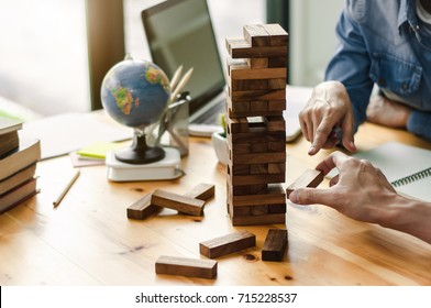 group of friends playing game wooden blocks, business start up building, risk and growth concept