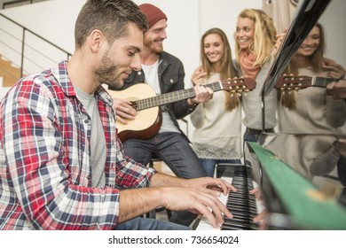 Group of friends playing music