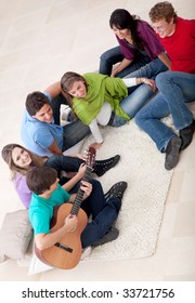Group of friends playing music and singing