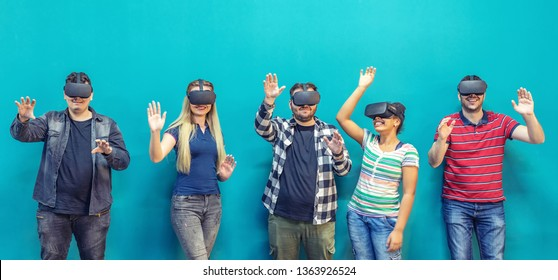 Group of friends playing on vr glasses indoor – virtual reality with people having fun together with wearable headset googles – digital generation trends with innovation video glasses