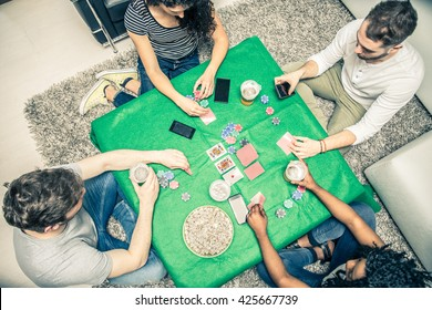 Group of friends playing poker at home