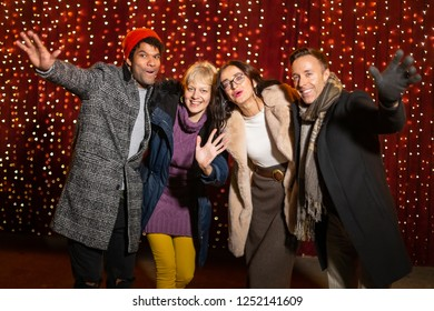 Group of friends posing for photo at Christmas market.