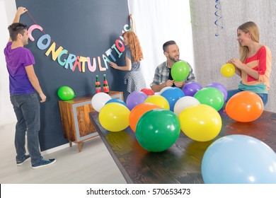 Group of friends and preparations for surprise graduation party