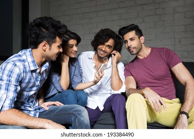group of friends reading a message on smart phone.