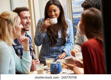 Group Of Friends Relaxing In Caf�¢?? Together