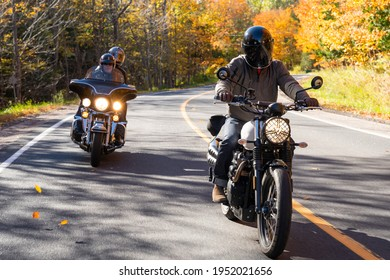 Group of friends riding motorcycles in the fall in Canada