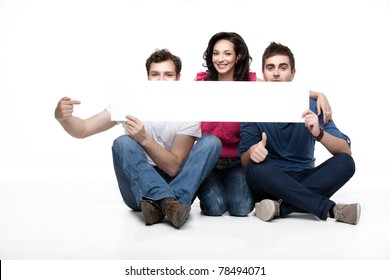 group of friends showing blank banner