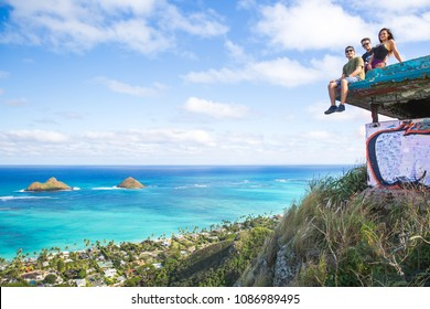 A group of friends sitting on pillbox over looking Lanikai in Kailua Hawaii