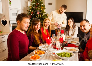 Group of friends sitting on the table at the Christmas