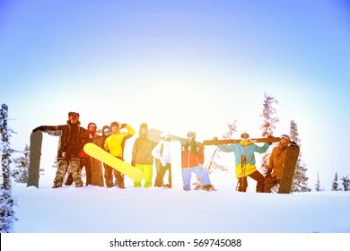 Group of friends at ski resort having fun. Skiing and snowboarding group concept