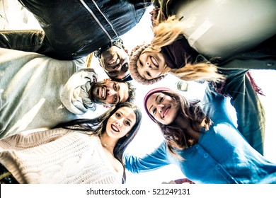 Group of friends smiling from above