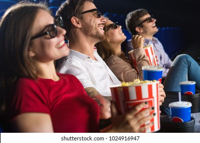 Group of friends smiling cheerfully watching a movie together at the cinema copyspace enjoyment recreation weekend leisure entertaining lifestyle friendship premiere spectators showtime.