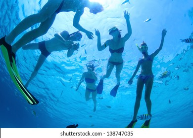 Group of friends snorkeling in a tropical sea