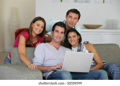 Group of friends in sofa at home