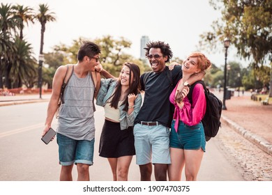 A group of friends spending time together in the city on a sunny warm summer day.