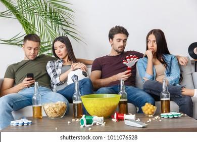 Group of friends sport fans watching football match bored