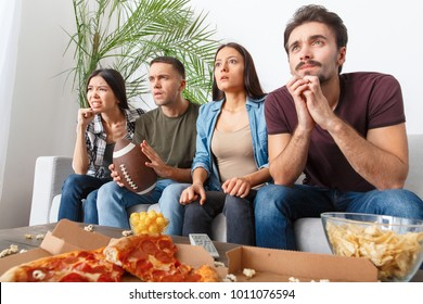 Group of friends sport fans watching rugby match nervous