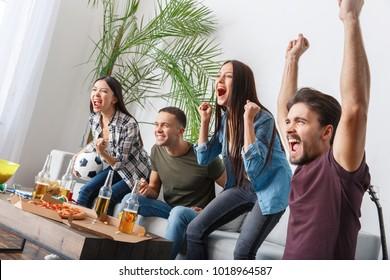 Group of friends sport fans watching match cheering team