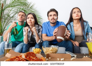 Group of friends sport fans watching match in colorful shirts baseball