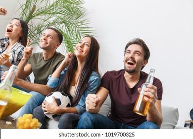 Group of friends sport fans watching soccer match goal