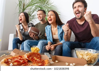 Group of friends sport fans watching rugby match victory