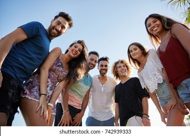Group of friends standing together outside smiling