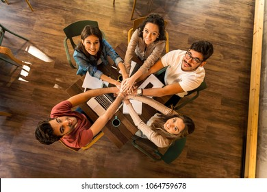 Group of friends studying together for finals