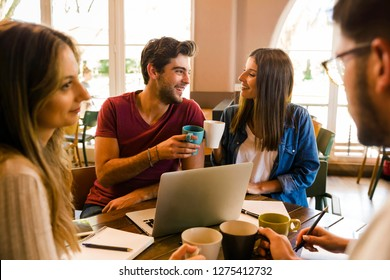 Group of friends studying together and having a good time