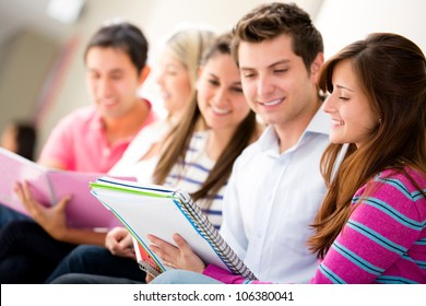 Group of friends studying together and smiling