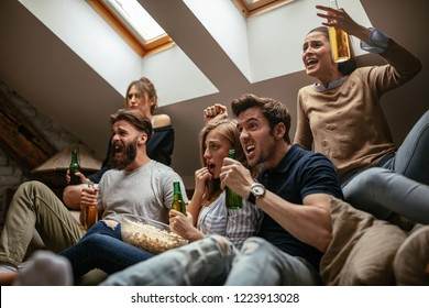 Group of friends supporting their club loudly