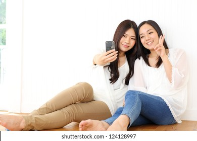 Group of friends taking picture with mobile phone