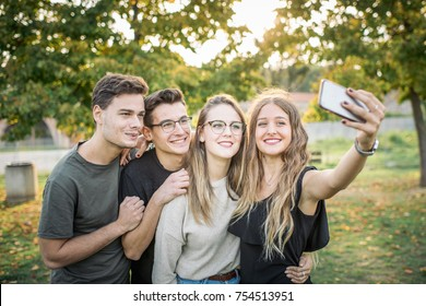 Group of friends taking a self portrait in the park.