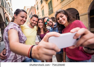 Group of friends taking a selfie in the city
