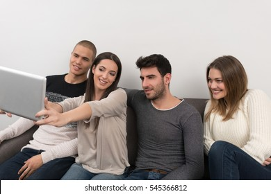 group of friends taking selfie photo with tablet at modern home indoors
