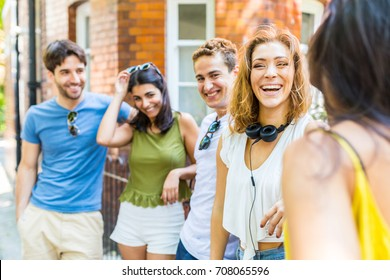 Group of friends talking and having fun. Multi ethnic people enjoying time together and laughing in London. Carefree and lifestyle concepts with real people