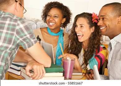 A group of friends are talking and smiling with each other.  Horizontal shot.