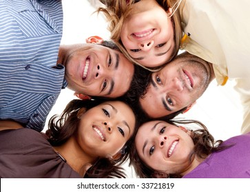 Group of friends with their head together in the middle isolated
