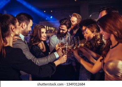 Group of friends toasting to becoming year!