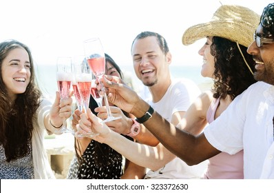 Group of friends toasting champagne sparkling wine at a relax party celebration gathering