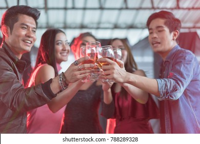 Group of friends toasting champagne sparkling wine at a relax party, celebration concept.