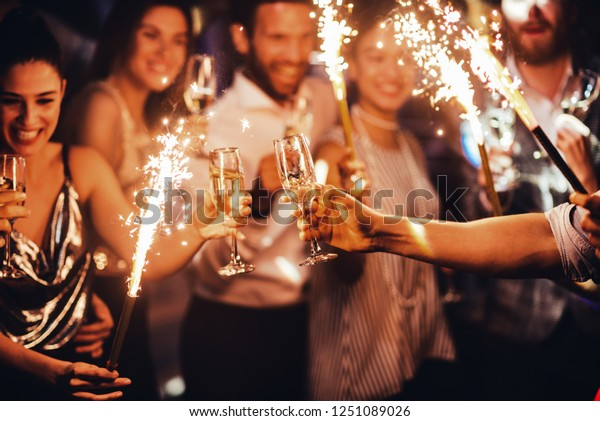 Group of friends toasting in the club
